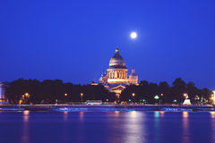 The Isaac cathedral in Saint-Petersburg. The Isaac cathedral and Neva river at night, Saint-Petersburg, Russia Royalty Free Stock Photo
