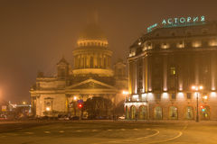 Isaac`s Cathedral and Astoria hotel foggy March night. Saint-Petersburg Stock Image