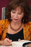 ISABEL ALLENDE. AT THE BOOK FAIR OF MADRID ON JUNE 11, 2011 SIGNS ITS BOOKS stock photos