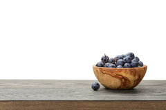 Isabella grapes in wood bowl on table, border Royalty Free Stock Photos