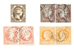 Isabella II Stamps. Spanish Isabella II used stamps. Queen of Spain. Isolated on white. Circa 1851 - 1861 Stock Photography