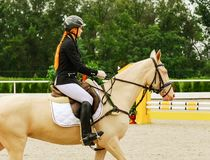 Beautiful girl and horse in jumping show, equestrian sports. royalty free stock image