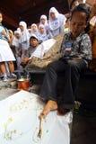 Isabilities  make batik Stock Photos