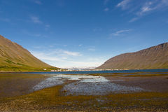 Isafjordur town - Iceland. Iceland in background Isafjordur  town. Summer sunny day Royalty Free Stock Photos