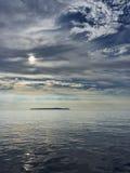 Isaland και σύννεφα Στοκ φωτογραφίες με δικαίωμα ελεύθερης χρήσης