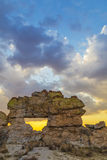 Isalo rock landmark at dusk in Madagascar, Africa. Blue cloudscape on a shining yellow sunset landscape on Isalo rock gate, famous landmark in Madagascar, Africa Stock Photos