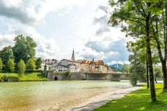 Isar river and bridge that leads to old town Bad Tolz, Bavaria, Germany Stock Photos