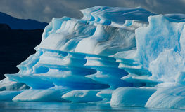 Isberg i vattnet, glaciären Perito Moreno arenaceous Fotografering för Bildbyråer