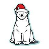 Isbjörn för vit jul med jultomtenhatten Arkivfoto
