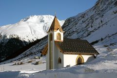 Ischgl Austria Church Snow Drifts. Small Church, Situated in Ischgl, Austria Stock Photography