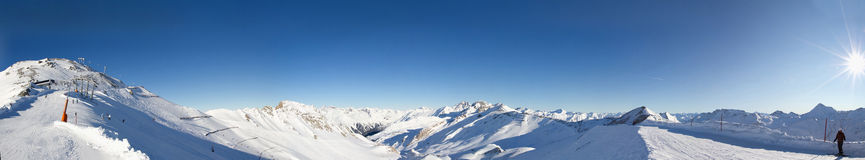 Ischgl, Austria Panorama. Ischgl, Austria is one of one of the world's largest ski areas. Panorama of snow-covered ski slopes on a sunny day Stock Photography