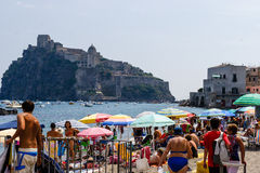 Ischia Island. A small beach on Ischia island looking out towards Castello Aragonese in mid summer Stock Image