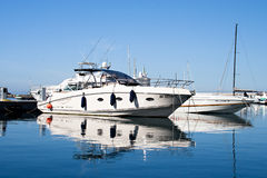 ISCHIA, ITALY - OCTOBER, 10: White big yacht in dock on smooth surface of the sea, October 10, 2012 Royalty Free Stock Image