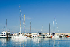 ISCHIA, ITALY - OCTOBER, 10: Yachts in dock with blue sky and sea in sunny day, October 10, 2012 Stock Photos