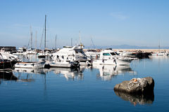 ISCHIA, ITALY - OCTOBER, 10: Yachts in dock on smooth surface of the water, October 10, 2012 Royalty Free Stock Photo