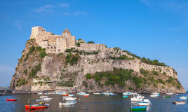 Ischia port, Aragonese Castle and colorful boats Royalty Free Stock Photos