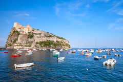 Ischia port, Aragonese Castle and small boats Royalty Free Stock Images