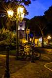 Ischia Streets. A dusk scene from a small town on Ischia island, off the coast of mainland Italy. With a bike leaning against a lamp post royalty free stock image