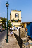 Ischia Streets. A man reads a newspaper as he walks down a small street in the town of Ischia on Ischia island, off the coast of Italy royalty free stock image