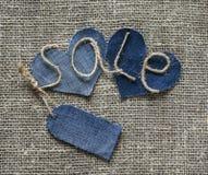 Iscrizione alla moda dalla vendita di cordicella in mia mano con un prezzo t Fotografia Stock Libera da Diritti