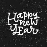 Iscrizione della mano del buon anno sul fondo nero Immagine Stock