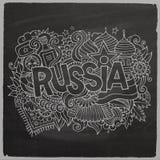 Iscrizione della mano di vettore della Russia ed elementi di scarabocchi Fotografia Stock
