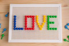Iscrizione di amore con gli elementi del mosaico Saluto di giorno del ` s del biglietto di S. Valentino Fotografia Stock Libera da Diritti