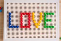 Iscrizione di amore con gli elementi del mosaico Saluto di giorno del ` s del biglietto di S. Valentino Immagini Stock
