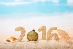 Iscrizione di Natale sulla sabbia dorata Immagine Stock