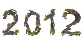 Iscrizione di pietra astratta 2012 con l'erba verde Fotografia Stock Libera da Diritti