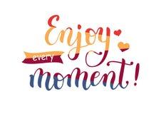 Iscrizione Enjoy ogni momento in quattro colori Fotografia Stock