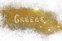 Iscrizione Grecia sulla scintilla dorata di scintillio su fondo bianco Immagine Stock Libera da Diritti