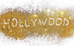 Iscrizione Hollywood sulla scintilla dorata di scintillio su fondo bianco Fotografie Stock Libere da Diritti