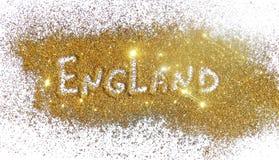 Iscrizione Inghilterra sulla scintilla dorata di scintillio su fondo bianco Immagine Stock Libera da Diritti
