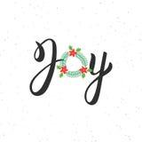 Iscrizione moderna dell'iscrizione della spazzola scritta mano di gioia Testo di Noel dell'iscrizione con la corona di Natale Pro Fotografia Stock