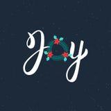 Iscrizione moderna disegnata a mano dell'iscrizione della spazzola di gioia Testo di Noel dell'iscrizione con la corona di Natale Immagini Stock Libere da Diritti