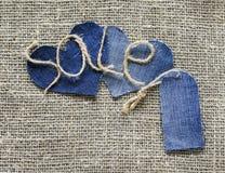 Iscrizione originale dalla vendita di cordicella in mia mano con un PR Immagine Stock