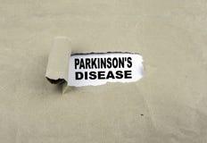 Iscrizione rivelatrice su vecchia carta - Parkinson& x27; malattia di s fotografia stock libera da diritti