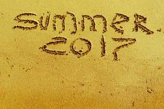 Iscrizione su estate 2017 della sabbia Fotografia Stock
