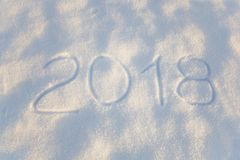 Iscrizione 2018 sulla superficie della neve Fotografia Stock Libera da Diritti