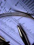 ISD Listing. A vintage picture of the listing of ISD codes through glasses with a golden pen Royalty Free Stock Images