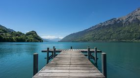 Pier into the lake Brienzersee in Iseltwald Switzerland. Iseltwald, Switzerland, May 2017: The Pier into the lake Brienzersee Royalty Free Stock Photo