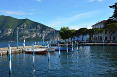 ISEO, ITALY - MAY 13, 2017: View of the pier of Iseo Lake with boats, Iseo, Italy. Stock Photography