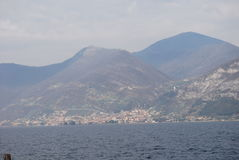 Iseo Lake. With mountain and ferryboat Stock Photo