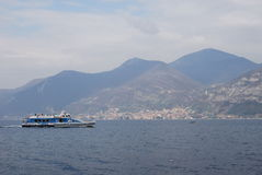 Iseo Lake. With mountain and ferryboat Stock Images