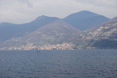 Iseo Lake. With mountain and ferryboat Royalty Free Stock Photo