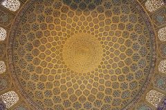 Isfahan. Interior view of the lofty dome covered with polycrome tiles at the Sheikh Lutfollah Mosque. Sheikh Lutfollah Mosque  is one of the architectural Royalty Free Stock Photo