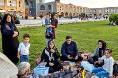 Iranian family is resting of square Naghshe Jahan, Isfahan, Iran royalty free stock image