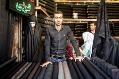 ISFAHAN, IRAN - AUGUST 20, 2016: Islamic outfit seller hijab, veils and scarfs in Isfahan bazaar Royalty Free Stock Photo
