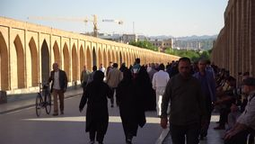 Iranian people on SioSePol or Bridge of 33 arches, Isfahan, Iran stock video